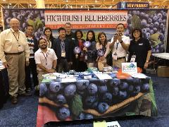 2 - Cochran Delegation from Myanmar at the U.S. Highbush Blueberry Council booth